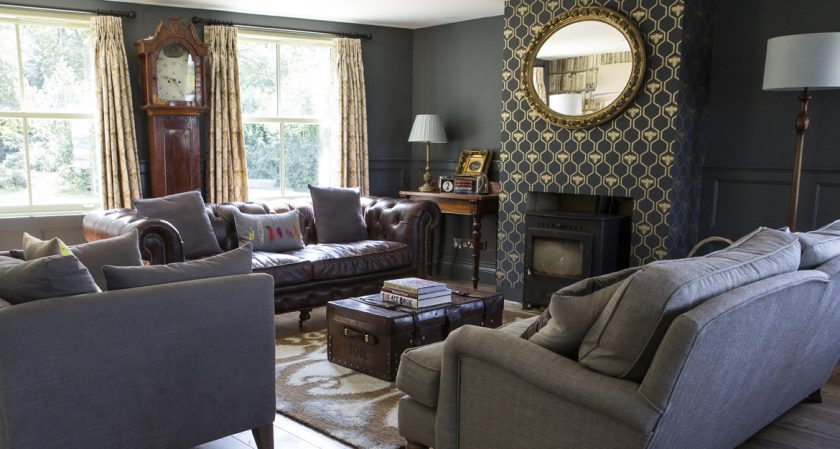 Old Sir Walter Tyrrell, a luxury rental cottage in the New Forest. 4 bedrooms and 3 bathrooms. Relax in the cozy lounge.