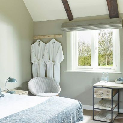 The Fish Hotel, new hotel opening in the Costwolds in June 2015. Rooms start at £125 including full English breakfast. This is one of the lovely bedrooms in green tones.