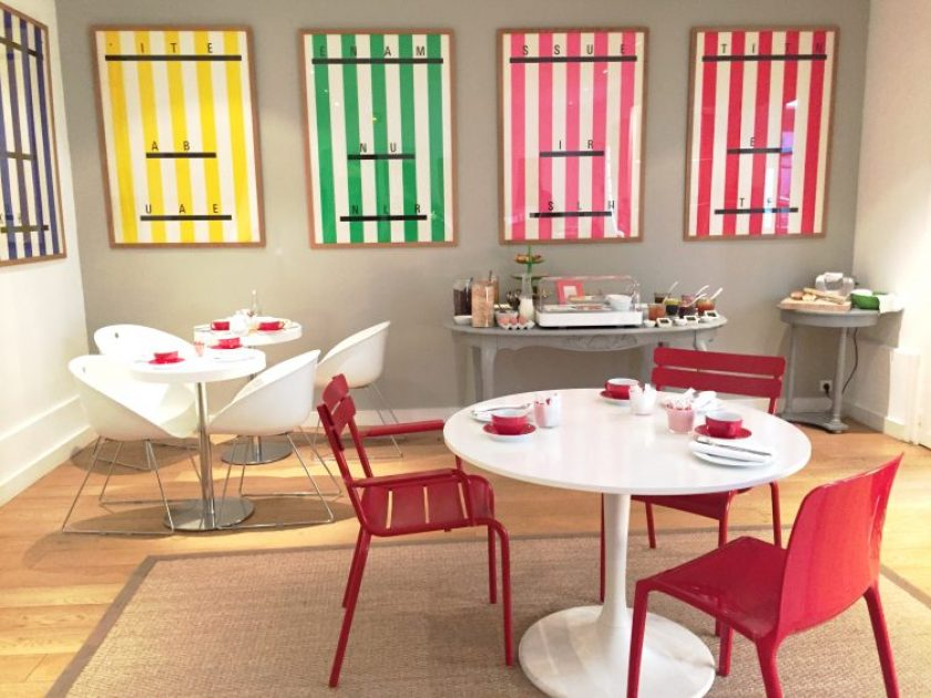 The colourful breakfast room at Hotel Arvor, an affordable stylish Paris hotel.