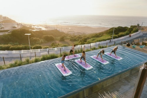 Noah surfhouse in Portugal, one of the beach hotels with heated pool in Europe that this article features. Read the whole piece for 20 more ideas