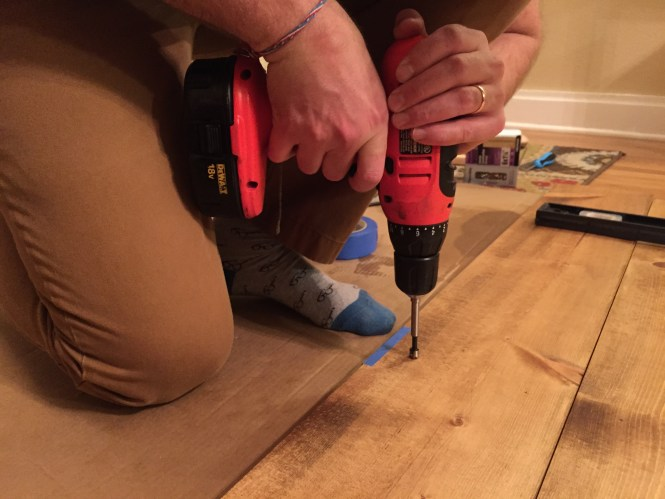 Jesse using a forstner bit to drill recesses for headboard screws