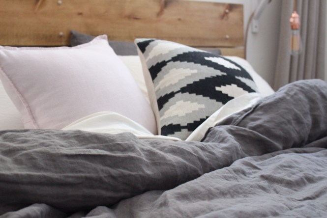 Cozy gray, pale pink linen bedding