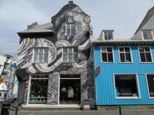 Shops, homes and structures are often adorned with ornate murals. This one can be found on the shopping street Laugavegur.