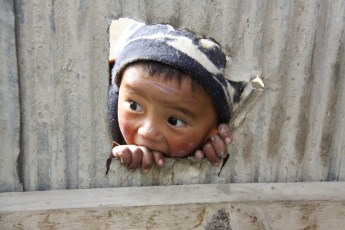 An inquisitive young resident of Lo Manthang