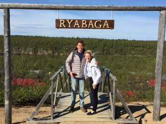 """William and Mollie on arrival at Ryabaga and the """"Stairway to Heaven"""""""