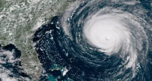 7,000 troops, warships attack Hurricane Florence
