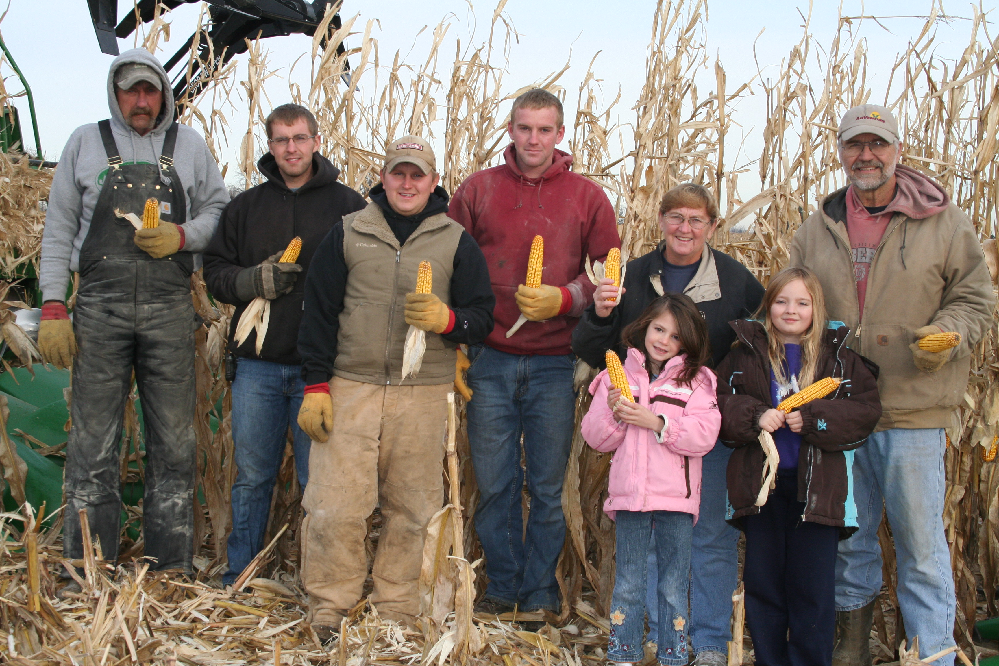 The harvest on Jerry and Bonnie Boldt's farm west of Davenport always ends with the hand-picking of the last of the corn crop in honor of deceased ancestors and others. This year's harvest took on special meaning, though, because the farm has now been in the Boldt family for 100 years. The hand-pickers this year were (l-r) Mike Fink, Jared Boldt, Jake Peeters, Jorden Boldt, Kaylee Wulf, Bonnie Boldt, Kylie Boldt and Jerry Boldt.