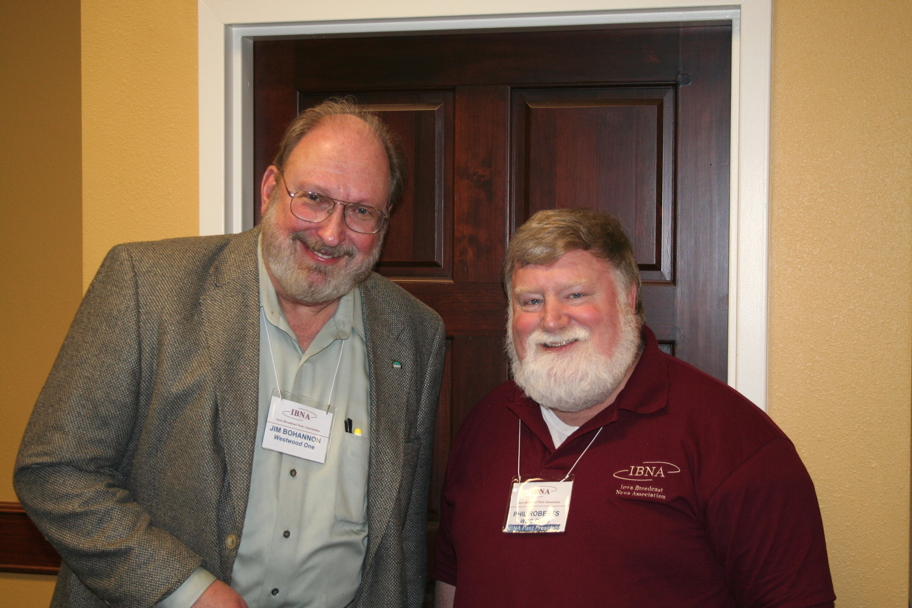 Jim Bohannon, left, a nationally syndicated radio talk show host and a panelist and the keynote speaker atthe 2009 Iowa Broadcast News Association convention inAmes, chats with Phil.