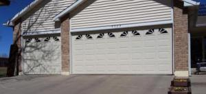 Beige Insulated Steel, traditional style garage door with decorative windows