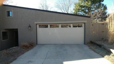Beige Contemporary Style Flush Garage door with windows at the top