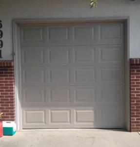 Small Gray insulated Steel, traditional style garage door