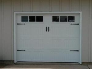 Small White Carriage Style garage door with decorative windows