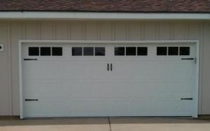 White Carriage Style garage door with decorative windows