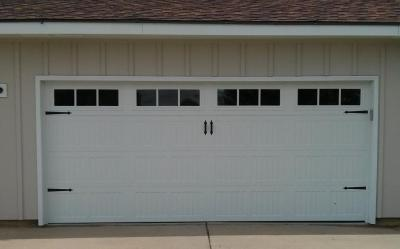 White Carriage Style garage door with decorative windows