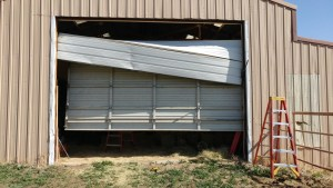 Garage door broken by a car