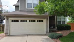 Beige Garage door with windows