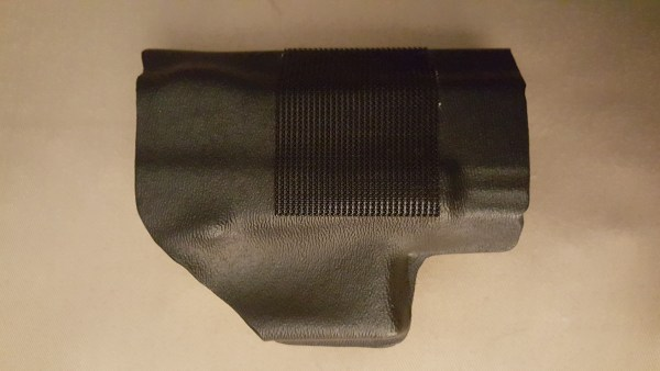 I added Velcro along the sides of each kydex insert and inside the cloth holsters in the belly band. This is what holds the kydex in place within the belly band holster.