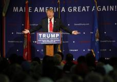 "FILE -- In this Dec. 7, 2015 file photo, Republican presidential candidate, businessman Donald Trump, speaks during a rally coinciding with Pearl Harbor Day at Patriots Point aboard the aircraft carrier USS Yorktown in Mt. Pleasant, S.C. The SITE Intelligence Group, which monitors jihadi websites, said Al-Qaida's branch in Somalia posted a video clip Friday, Jan. 1, 2016, of Trump calling for a ""total and complete shutdown of Muslims entering the United States"" in a recruitment video aimed at African-American youth. (AP Photo/Mic Smith, File)"
