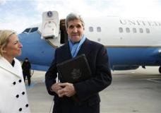 "U.S. Secretary of State, John Kerry, is greeted by the US Ambassador to Austria, Alexa Wesner, left, as he steps from his plane Saturday, Jan. 16, 2016, upon his arrival in Vienna, Austria on what is expected to be ""implementation day,"" the day the International Atomic Energy Agency (IAEA) verifies that Iran has met all conditions under the nuclear deal. (Kevin Lamarque/Pool Photo via AP)"
