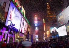 Confetti falls during the annual New Year's Eve celebration in Times Square on Friday, Jan. 1, 2016, in New York. (AP Photo/Kevin Hagen)