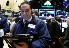 Trader Tommy Kalikas works on the floor of the New York Stock Exchange, Wednesday, Jan. 6, 2016. Stocks are opening lower as investors fret about signs of belligerence in North Korea and more weakening of China's economy. (AP Photo/Richard Drew)