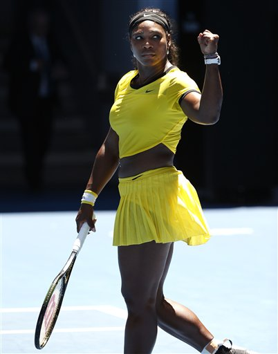 Serena Williams of the United States celebrates after beating Camila Giorgi of Italy during their first round match at the Australian Open tennis championships in Melbourne, Australia, Monday, Jan. 18, 2016.(AP Photo/Vincent Thian)