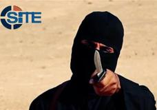 """FILE - This image made from militant video, which has been verified by SITE Intelligence Group and is consistent with other AP reporting, shows Mohammed Emwazi, known as """"Jihadi John,"""" who appeared in several videos depicting the beheadings of Western hostages. SITE, which tracks terrorist activity, says the Islamic State group is acknowledging the death of the masked militant and published a """"eulogizing profile"""" of him on Tuesday, Jan. 19, 2016, in its English-language magazine Dabiq. (SITE Intelligence Group via AP)"""