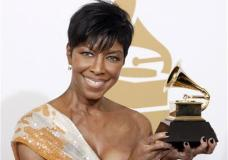 FILE - In a Sunday, Feb. 8, 2009 file photo, Natalie Cole holds the best instrumental arrangement accompanying vocalist award backstage at the 51st Annual Grammy Awards, in Los Angeles. Cole's family said the singer's cause of her death on Dec. 31, 2015, was idiopathic pulmonary arterial hypertension, which led to heart failure. (AP Photo/Matt Sayles, File)