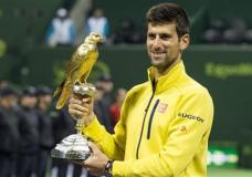 Novak Djokovic of Serbia holds the trophy after he won the men's final match against Spain's Rafael Nadal at the Qatar Open 2016, in Doha, Qatar, Saturday, Jan. 9, 2016. (AP Photo/Alexandra Panagiotidou)