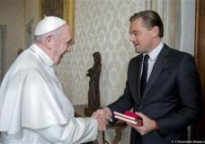 Pope Francis meets with actor Leonardo Di Caprio during a private audience in the pontiff's private studio, at the Vatican, Thursday, Jan. 28, 2016. (L'Osservatore Romano/Pool Photo via AP)