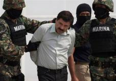 "FILE - In this Feb. 22, 2014 file photo, Joaquin ""El Chapo"" Guzman is escorted to a helicopter in handcuffs by Mexican navy marines at a navy hanger in Mexico City, Mexico. Mexican President Enrique Pena Nieto posted on his Twitter account, Friday, Jan. 8, 2016, that drug lord Joaquin 'Chapo' Guzman has been recaptured. (AP Photo/Eduardo Verdugo, File)"