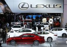 FILE - In this Jan. 13, 2014 file photo, attendees browse through the Lexus exhibit during media previews at the North American International Auto Show in Detroit. Lexus, Porsche and Buick are the most dependable vehicle brands, according to a new study by the consulting firm J.D. Power. (AP Photo/Paul Sancya, File)