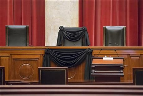 Supreme Court Justice Antonin Scalia's courtroom chair is draped in black to mark his death as part of a tradition that dates to the 19th century, Tuesday, Feb. 16, 2016, at the Supreme Court in Washington. Scalia died Saturday at age 79. He joined the court in 1986 and was its longest-serving justice. (AP Photo/J. Scott Applewhite)