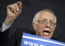 Democratic presidential candidate Sen. Bernie Sanders, I-Vt., speaks during a caucus night party, on Monday, Feb. 1, 2016, in Des Moines, Iowa. (AP Photo/Evan Vucci)