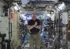 n this image from video made available by NASA, astronaut Scott Kelly speaks to reporters on Earth during a news conference held on the International Space Station on Thursday, Feb. 25, 2016. After nearly a year in space, Kelly is just a few days away from returning to Earth. He'll leave Tuesday on a Russian Soyuz capsule back to the planet to end NASA's longest space flight ever. (NASA via AP)