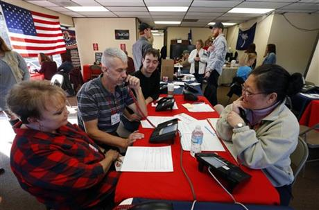 Volunteers make calls for Republican presidential candidate Sen. Ted Cruz, R-Texas, Tuesday, Feb. 16, 2016, in Greenville, S.C. For months, Cruz's campaign has touted an expensive and sophisticated get-out-the-vote operation as its antidote to Donald Trump's broad populist appeal. It worked in Iowa. But Saturday's South Carolina primary will be a tougher test for him. And it could shape the race between the anti-establishment rivals as the GOP contest heads toward delegate-rich March voting states.(AP Photo/Paul Sancya)