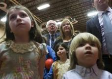 Democratic presidential candidate Sen. Bernie Sanders, I-Vt., center left, watches the for results with his wife Jane, center right, during a primary night watch party at Concord High School, Tuesday, Feb. 9, 2016, in Concord, N.H. (AP Photo/John Minchillo)