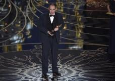 """Mark Rylance accepts the award for best actor in a supporting role for """"Bridge of Spies"""" at the Oscars on Sunday, Feb. 28, 2016, at the Dolby Theatre in Los Angeles. (Photo by Chris Pizzello/Invision/AP)"""