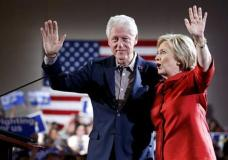 Democratic presidential candidate Hillary Clinton, right, waves on stage with her husband and former President Bill Clinton for a Nevada Democratic caucus rally, Saturday, Feb. 20, 2016, in Las Vegas. (AP Photo/John Locher)
