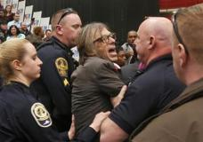 Photojournalist Chris Morris is escorted by police during the rally of Republican presidential candidate, Donald Trump, Monday, Feb. 29, 2016, at Radford University in Radford, Va. (AP Photo/Steve Helber)