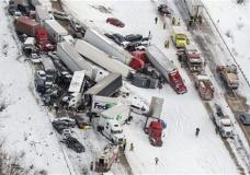 Vehicles pile up at the site of a fatal crash near Fredericksburg, Pa., Saturday, Feb. 13, 2016. The pileup left tractor-trailers, box trucks and cars tangled together across several lanes of traffic and into the snow-covered median. (James Robinson/PennLive.com via AP) MANDATORY CREDIT; MAGS OUT