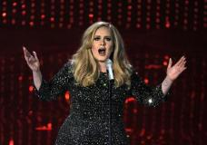 FILE - In this Feb. 24, 2013 file photo, singer Adele performs during the Oscars at the Dolby Theatre in Los Angeles. Adele is warming up for her upcoming concert tour with a special show for fans in Los Angeles on Friday. The singer announced Wednesday that she'll give a concert at The Wiltern concert venue on Friday, Feb. 12, 2016, three days before the Grammy Awards. To get in, fans in the California area need to be registered on her website, Adele.com. (Photo by Chris Pizzello/Invision/AP, File)