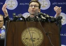 Washington Attorney General Bob Ferguson talks to reporters, Monday, Jan. 30, 2017, in Seattle. Ferguson announced that he is suing President Donald Trump over an executive order that suspended immigration from seven countries with majority-Muslim populations and sparked nationwide protests. (AP Photo/Ted S. Warren)
