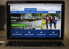 """FILE - In this Oct. 24, 2016 file photo, the HealthCare.gov 2017 web site home page as seen in Washington. The Obama administration says 11.5 million people have enrolled for coverage under the president's health care law as of Dec. 24. That's about 290,000 more sign-ups than last year at the same time, despite the Republican vow to repeal """"Obamacare."""" (AP Photo/Pablo Martinez Monsivais)"""