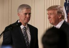 U.S. President Donald Trump looks on as Neil Gorsuch (L) approaches the podium after being nominated to be an associate justice of the U.S. Supreme Court at the White House in Washington, D.C., U.S., January 31, 2017. REUTERS/Carlos Barria