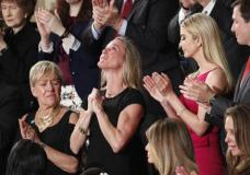 """Carryn Owens, widow of widow of Chief Special Warfare Operator William """"Ryan"""" Owens, is applauded on Capitol Hill in Washington, Tuesday, Feb. 28, 2017, as she was acknowledged by President Donald Trump during his address to a joint session of Congress. (AP Photo/Pablo Martinez Monsivais)"""