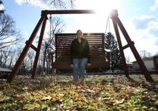 "In this Monday, Jan. 30, 2017, photo, Ashley Grant sits on a swing near her home in Bridgeton, N.J. Drug addicts caught up in the nation's opioid-abuse crisis are worried about what will happen if the Trump administration makes good on its vow to repeal the Affordable Care Act. Grant, a recovering heroin addict is hoping to regain custody of her three children. ""They should make it easier for people with addiction to get insurance,"" she said. (AP Photo/Mel Evans)"