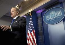 In this Feb. 21, 2017, file photo, White House press secretary Sean Spicer speaks during the daily press briefing at the White House in Washington. The Trump administration could revise or withdraw an Obama-era directive requiring public schools to let transgender students use bathrooms and locker rooms that match their chosen gender identity. Spicer said Tuesday the Justice Department is working on a new set of guidelines on bathroom access but offered no other details. (AP Photo/Andrew Harnik)