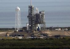 A Space X Falcon9 rocket sits on the launch pad, Saturday, Feb. 18, 2017 at the Kennedy Space Center in Cape Canaveral, Fla Last-minute rocket trouble forced SpaceX on Saturday to delay its inaugural launch from NASA's historic moon pad. SpaceX halted the countdown with just 13 seconds remaining. The problem with the second-stage thrust control actually cropped up several minutes earlier. With just a single second to get the Falcon rocket airborne, flight controllers could not resolve the issue in time. (Red Huber/Orlando Sentinel via AP)