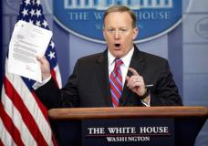 White House press secretary Sean Spicer holds up a document concerning a Washington Post story on Sally Yates as he talks to the media during the daily press briefing at the White House in Washington Tuesday, March 28, 2017. Spicer discussed the Supreme Court nominee Justice Neil Gorsuch, jobs, healthcare, and other topics. (AP Photo/Andrew Harnik)